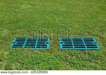 Manhole Drainage Grates On The Lawn With Green Grass Septic Tank Cover, Sump Cesspool Drainage Syste