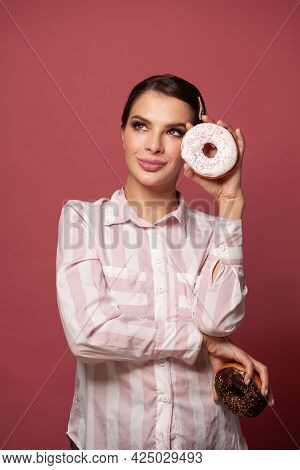 Pretty Stylish Woman In Striped Shirt Holding Fresh Donuts With Powder Ready To Enjoy Sweets. Portra