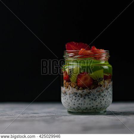 Breakfast Of Yogurt With Chia Seeds, Kiwi, Strawberries And Muesli. A Healthy Fodmap Breakfast. The