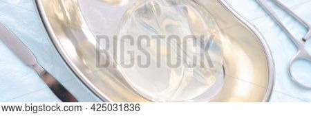 Silicone Breast Implants Lying In Breast Implants Lying In Surgical Metal Tray Closeup