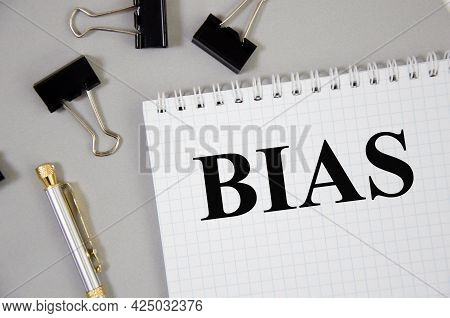 Handwriting Text Bias Mistake Word Written On Gray Background With Pencils And Paper Clips. Word