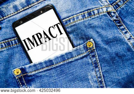 Impact The Text Is Written On The White Screen Of The Phone Shortly Lies In Jeans