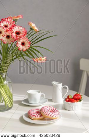 Breakfast In The Kitchen On A Sunny Morning. Romantic Brunch. Bouquet Of Gerberas, Strawberries And