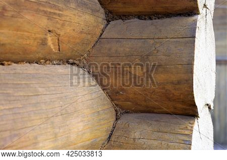 Log Construction. Corner Of A House From A Bar, Logs Close-up. Log House Or Barn.