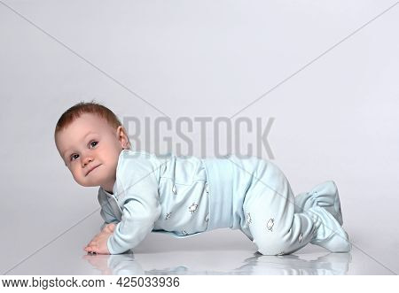 Creeping Funny Boy In Body. He Sits On The Floor, Isolated On A White Studio Background. Concept For