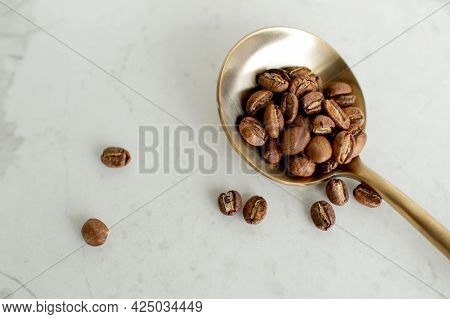 Roasted Coffee Beans Sitting Displayed On A Table With White Bacground No People