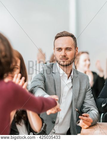 Business Partners Confirming The Deal With A Handshake