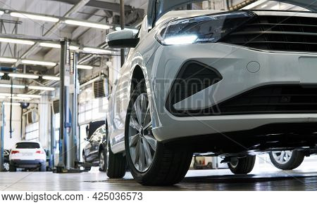 Moscow Russia - June 2021:white Clean Beautiful Car In A Car Service. The Front Of The Car Is Shown