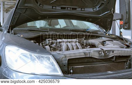 Moscow Russia - June 2021: A Modern Car In A Car Service With An Open Hood. A Slightly Dusty Engine