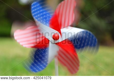 Close Up Of Spinning Red, White And Blue Fourth Of July Pinwheel In The Lawn