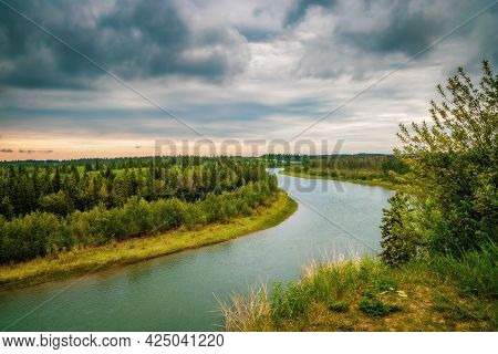 Moody Clouds Over The Red Deer River In The Summer