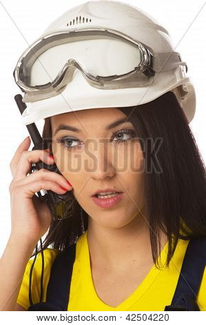 Serious female construction worker talking with a walkie talkie isolated on white poster