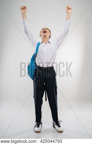 A Boy Raises His Hand In A Junior High School Uniform In High Spirits With A School Bag