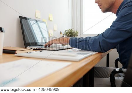 Cropped Image Of Businessman Working On Laptop At His Office Desk, He Is Filling Calendar With Thing