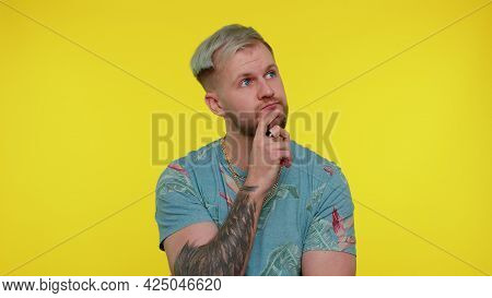 Thoughtful Clever Bearded Stylish Man 30s Years Old Rubbing His Chin And Looking Aside With Pensive