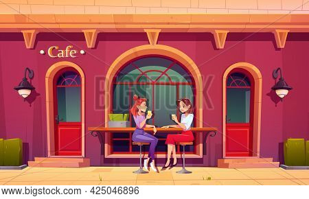 Girls On Outdoor Cafe Terrace. Women Drink Tea And Talking Sit On High Stools At Wooden Counter Bar.