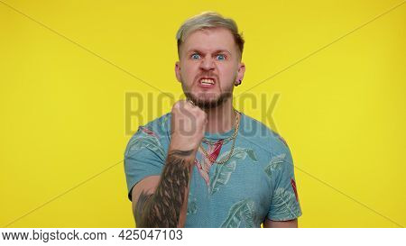 Aggressive Angry Sincere Tourist Adult Guy 30 Years Old In T-shirt Trying To Fight At Camera, Shakin