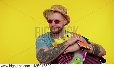 Displeased Tired Boring Traveler Tourist Man In Summer Clothes On Yellow Background. Bearded Stylish