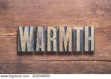 Warmth Word Combined On Vintage Varnished Wooden Surface