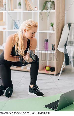 Weight Workout. Sportive Woman. Online Training. Home Fitness. Happy Lady In Black Sportswear Leanin