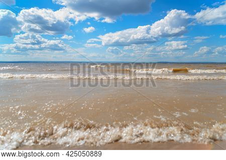 The Sea Shore, Waves On The Water And Clouds In The Sky