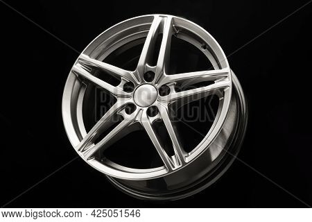 Alloy Wheel, Sporty Alloy, In The Shape Of A Star On A Dark Background
