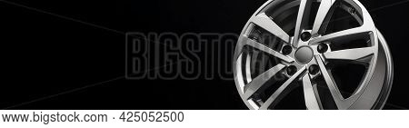 Gray Modern Alloy Wheel Side View On A Black Background Of Copy Space, A Place For Advertising A Car