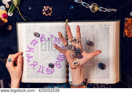 Astrology And Horoscope. The Fortune Teller's Hand Holds The Zodiac Stones In The Palm Of Her Hand O
