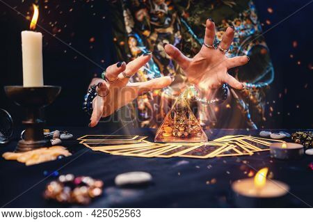 The Witch Had Spread Out The Tarot Cards On The Table And Was Reading Over The Pyramid. Hands Close-