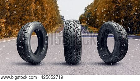 Three Winter Tire Wheels On An Autumn Road. The First Snow Or Snow With Rain. A Dangerous Route. Saf