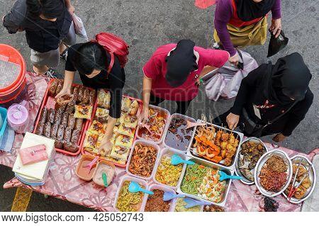 Kota Kinabalu,sabah,malaysia-mac 14,2016:people Buying Food At Street Food Stalls Hawker Kota Kinaba