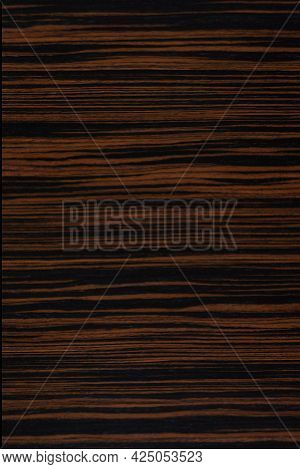 Makassar Ebony Veneer Background In Dark Color, Texture For Design Work.