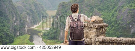 Banner, Long Format Man Tourist In Boat On The Lake Tam Coc, Ninh Binh, Viet Nam. Its Is Unesco Worl