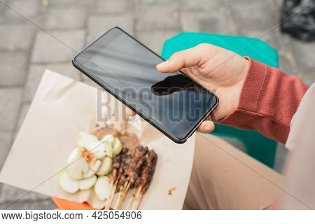 Taking Picture Of Chicken Satay Using Mobile Phone