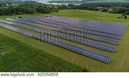 Aerial View Of Solar Panels Farm Solar Cell With Sunlight. Drone Flight Over Solar Panels Field, Ren