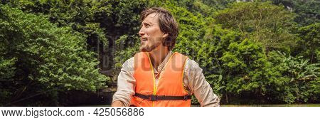 Banner, Long Format Man Tourist In Trang An Scenic Landscape Complex In Ninh Binh Province, Vietnam