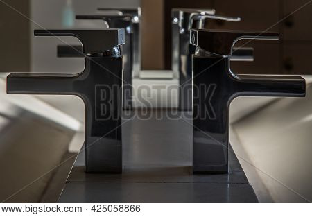 Modern Bathroom Washbasin With Chrome Faucet And White Tiling. Modern Design Of Bathroom. Space For