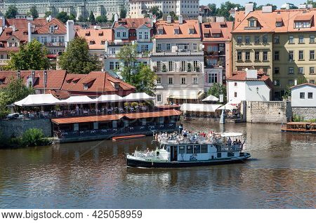 Prague, Czech Republic - July 23, 2019: Old Pleasure Boat With Tourists On Vltava River In Center Of