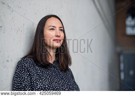 Portrait Of Mid Adult Businesswoman Standing Indoors. Copy Space.