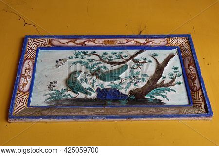 Hoi An, Vietnam, May 23, 2021: Detail Of The Relief Decoration Of The Van Thanh Mieu Cam Pho Temple