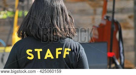 Female Staff Member On Patrol At An Outside Event.
