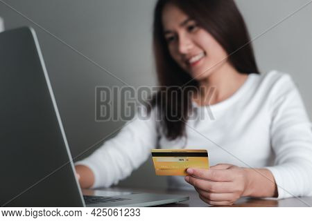 Asian Woman Holding Credit Card And Using Laptop Computer,  E-commerce, Internet Banking, Online Sho