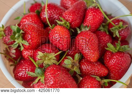 Red Ripe Strawberries In The Bowl, Top View