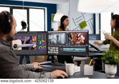 Creator Content Wearing Headphones Editing Film Montage In Post Production Software At Computer With
