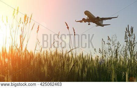 Airplane Flight On The Blue Summer Sky. Takeoff Or Landing Of A Passenger Plane With Traveling Touri