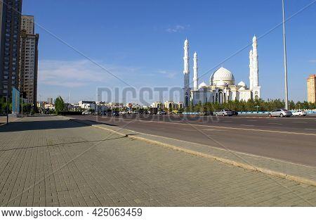 Nur-sultan - Kazakhstan: June 10, 2021: Mosque Hazret Sultan, Huge Flag And Highvill Park On Tauelsi