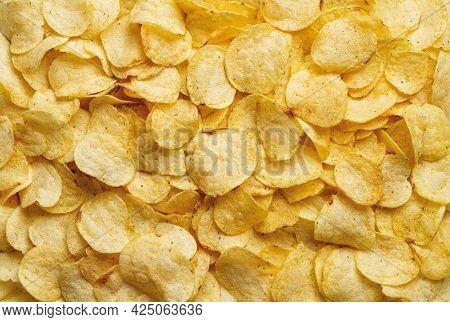 Texture Of Crispy Potato Chips. Delicious Potato Chips With Dill As A Background. Popular Snack Of P