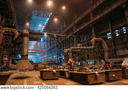Large Hangar Or Warehouse Of Metallurgical Plant, Dark Industrial Factory Interior, Heavy Industry.