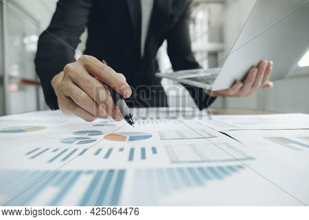 Businessman Planning And Analyse Investment Marketing Data.
