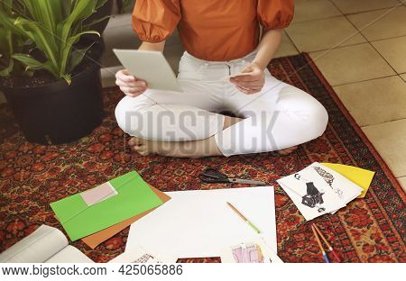 Young Woman Creating Her Feng Shui Wish Mapsitting On The Carpet In The Room In Boho Style With A Lo
